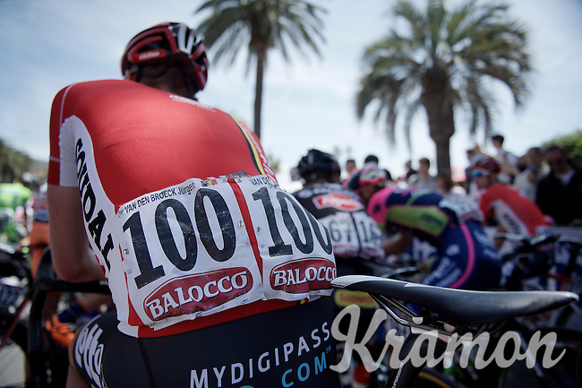 """The very unique #100 is worn by belgian Jurgen Van den Broeck (BEL/Lotto-Soudal).<br /> Normally there are no numbers ending with a zero in cycling races as every team starts with a #1 as the last digit and up 1 for every team rider racing (max 9, so ending with #9).<br /> BUT ever since the tragic death of Wouter Weylandt (4 years earlier) the Giro race organisers promised to never ever use his race number #108 again... and therefore the team leader of the """"100"""" squad, wears the #100 (instead of 101) in memory of WW.<br /> #WW108 sempre con noi/#WW108 always with us<br /> <br /> <br /> 2015 Giro<br /> stage 3: Rapallo - Sestri Levante (136km)"""