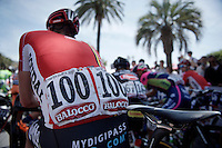 "The very unique #100 is worn by belgian Jurgen Van den Broeck (BEL/Lotto-Soudal).<br /> Normally there are no numbers ending with a zero in cycling races as every team starts with a #1 as the last digit and up 1 for every team rider racing (max 9, so ending with #9).<br /> BUT ever since the tragic death of Wouter Weylandt (4 years earlier) the Giro race organisers promised to never ever use his race number #108 again... and therefore the team leader of the ""100"" squad, wears the #100 (instead of 101) in memory of WW.<br /> #WW108 sempre con noi/#WW108 always with us<br /> <br /> <br /> 2015 Giro<br /> stage 3: Rapallo - Sestri Levante (136km)"