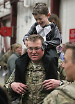 Zachary Krainbrink, 6, plays with his dad Sgt. 1st Class Benjamin Krainbrink after members of the 422nd Expeditionary Signal Battalion of the Nevada National Guard returned home Sunday, Jan. 15, 2012, after a yearlong deployment to Afghanistan. Hundreds of family and friends greeted the soldiers at the Nevada Air Guard Base in Reno, Nev..Photo by Cathleen Allison