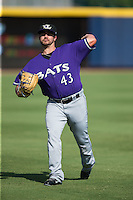 Louisville Bats starting pitcher Brandon Finnegan (43) warms up in the outfield prior to the game against the Durham Bulls at Durham Bulls Athletic Park on August 9, 2015 in Durham, North Carolina.  The Bulls defeated the Bats 9-0.  (Brian Westerholt/Four Seam Images)