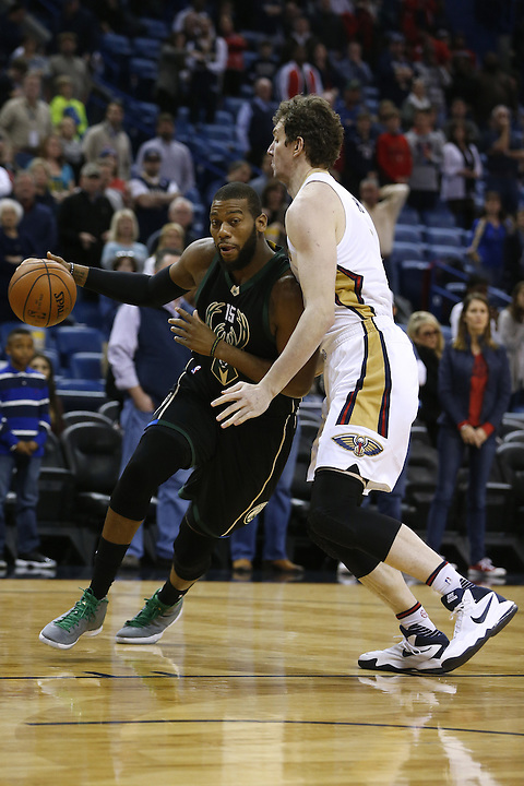Milwaukee Bucks center Greg Monroe (15) drives against New Orleans Pelicans center Omer Asik, right, during the first half of an NBA basketball game Saturday, Jan. 23, 2016, in New Orleans. (AP Photo/Jonathan Bachman)