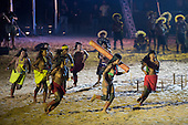 Kanela women participants compete at carrying the tree trunk during the opening ceremony at the first ever International Indigenous Games, in the city of Palmas, Tocantins State, Brazil. Photo © Sue Cunningham, pictures@scphotographic.com 23rd October 2015
