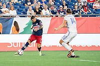 FOXOBOROUGH, MA - AUGUST 21: Gustavo Bou #7 of New England Revolution crosses the ball towards the FC Cincinnati goal during a game between FC Cincinnati and New England Revolution at Gillette Stadium on August 21, 2021 in Foxoborough, Massachusetts.