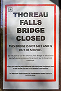 "May 23, 2018 - Thoreau Falls Trail bridge closed sign. The Thoreau Falls Trail bridge, which crosses the East Branch of the Pemigewasset River, in the Pemigewasset Wilderness is not safe and is out of service. The trail is still open, but hikers will have to ford the river at this location.<br /> <br /> The sign states: ""Do not plan to use the Thoreau Falls Trail bridge as it has been partially decommissioned to prevent use in its current condition. Hikers must exercise good judgment and should have contingency plans in case fording the river at this location is not possible."""