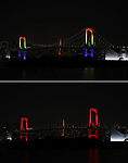 """June 2, 2020, Tokyo, Japan - This picture shows the Rainbow Bridge lit up from rainbow colors to red color for the """"Tokyo alert"""" in Tokyo on Tuesday, June 2, 2020. Tokyo Metropolitan government confirmed 34 people became infected with the new coronavirus on the day and Governor Yuriko Koike warned the """"Tokyo alert"""" for Tokyo residents.     (Photo by Yoshio Tsunoda/AFLO)"""
