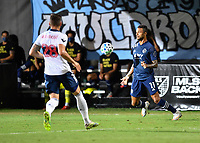 LAKE BUENA VISTA, FL - JULY 26: Khiry Shelton of Sporting KC settles the ball off his chest during a game between Vancouver Whitecaps and Sporting Kansas City at ESPN Wide World of Sports on July 26, 2020 in Lake Buena Vista, Florida.