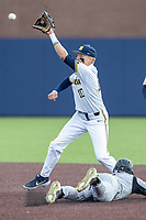 Michigan Wolverines second baseman Blake Nelson (10) waits for a throw from the catcher against the Western Michigan Broncos on March 18, 2019 in the NCAA baseball game at Ray Fisher Stadium in Ann Arbor, Michigan. Michigan defeated Western Michigan 12-5. (Andrew Woolley/Four Seam Images)