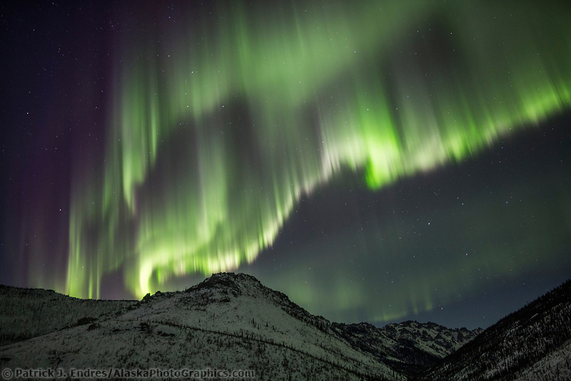 Colorful display of the northern lights over the White mountains in Alaska's interior. White Mountains National Recreation Area.