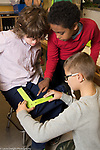 Public elementary school for gifted children grades K-6: Science lab three students measuring range of motion, Grade 5