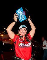 Nov 1, 2020; Las Vegas, Nevada, USA; NHRA pro stock driver Erica Enders celebrates after winning the NHRA Finals and the 2020 pro stock World Championship at The Strip at Las Vegas Motor Speedway. Mandatory Credit: Mark J. Rebilas-USA TODAY Sports