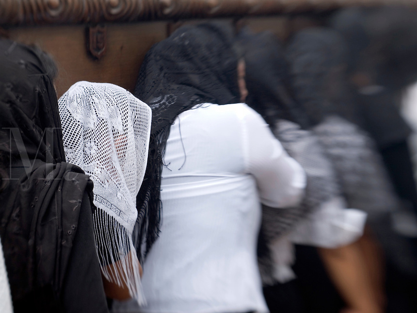 In observance of  Lent in Antigua (La Antigua)  Guatemala, the Catholic celebrations leading to Holy Week, images of Jesus and the Holy Virgin  are carried from their churches through the city on the shoulders of devoted women.