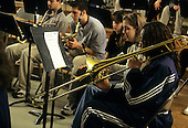 MR / Schenectady, New York. John Sayles School of Fine Arts at Schenectady High School (arts school within a school at an urban public high school). Girl (16, African-American) plays trombone with other students at jazz band rehearsal. MR: Cla13. © Ellen B. Senisi