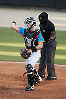 Pescados de Carolina catcher Wes Clarke (5) makes a throw to third base following a strikeout during the game against the Delmarva Shorebirds at Five County Stadium on September 4, 2021 in Zebulon, North Carolina. (Brian Westerholt/Four Seam Images)
