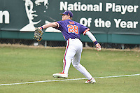 Clemson Tigers right fielder Seth Beer (28) makes a throw during a game against the Maine Black Bears at Doug Kingsmore Stadium on February 20, 2016 in Clemson, South Carolina. The Tigers defeated the Black Bears 9-4. (Tony Farlow/Four Seam Images)