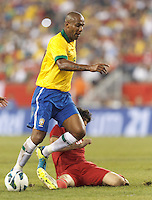 Brazil defender Maicon (15) drive to the net is thwarted. In an international friendly, Brazil (yellow/blue) defeated Portugal (red), 3-1, at Gillette Stadium on September 10, 2013.