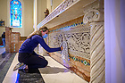 September 24, 2021; Megan Pelino '15 cleans the altar at Our Lady of the Angels Church in Chicago during the Alumni Association service event of the 2021 Shamrock Series. (Photo by Matt Cashore/University of Notre Dame)