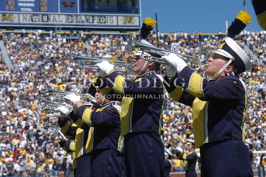 Trumpet players of the Michigan Marching band during the Wolverine's 50-3 blowout of Houston on Saturday, September 6, 2003 at Michigan Stadium in Ann Arbor, Mich (TONY DING/The Michigan Daily).