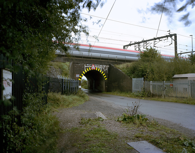 © John Angerson<br /> 8th August 1963.<br /> The Great Train Robbery was the robbery of a Royal Mail train heading from Glasgow to London on the West Coast Main Line. At Bridego Railway Bridge, (now called Mentmore Bridge) near Ledburn, Buckinghamshire, UK. A human chain of robbers removed 120 sacks containing two-and-a-half-tons of money. The robbery was well organised and swift. The second carriage from the front of the train was a High Value Package carriage, where registered mail was sorted. Much of this consisted of cash. Usually the value of these items would have been in the region of £300,000 but, because there had been a Bank Holiday weekend in Scotland the total on the day of the robbery value was higher (about £30 million today).