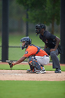 Umpire Jaylen Goodman and GCL Astros catcher Gerry Castillo (8) during a Gulf Coast League game against the GCL Nationals on August 9, 2019 at FITTEAM Ballpark of the Palm Beaches training complex in Palm Beach, Florida.  GCL Nationals defeated the GCL Astros 8-2.  (Mike Janes/Four Seam Images)