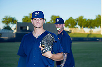 AZL Brewers Landon Holifield (46) is photobombed by Bowden Francis (60) while posing for a photo before a game against the AZL Cubs on August 24, 2017 at Maryvale Baseball Park in Phoenix, Arizona. AZL Cubs defeated the AZL Brewers 9-1. (Zachary Lucy/Four Seam Images)
