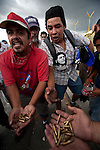 5 July 2009 - Tegucigalpa, Honduras  Supporters of ousted Honduras' President Manuel Zelaya holds bullets shot by soldiers at the protesters at the international airport in Tegucigalpa. At least one person was killed and ten were badly wounded in Honduras on Sunday when protesters demanding the return of Zelaya clashed with troops at the main airport in the capital. Photo credit: Benedicte Desrus