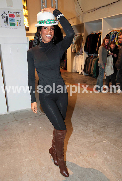**ALL ROUND PICTURES FROM SOLARPIX.COM**.**NO UK NEWSPAPER PUBLICATION**.**UK MAGAZINE & SUPPLEMENT PUBLICATION ONLY** AND NO PUBLICATION IN AUSTRALIA, BELGIUM, FRANCE, GERMANY, ITALY, SCANDINAVIA AND USA** .US singer Kelly Rowland surprised shoppers when she popped into Elton Johns 'Out The Closet' shop in London's Covent Garden to try on some outfits this afternoon.Members of the public have been given the chance to own Elton John and David Furnish's flamboyant clothing collection, direct from their wardrobes. Outfits worn by Elton on stage plus accessories, including sunglasses, luggage and belts are all being sold with proceeds going to the  Elton John AIDS Foundation. ..This pic:Kelly Rowland..JOB REF:         SFE       DATE: .**MUST CREDIT SOLARPIX.COM OR DOUBLE FEE WILL BE CHARGED**.**MUST NOTIFY SOLARPIX OF ONLINE USAGE**.**CALL US ON: +34 952 811 768 or LOW RATE FROM UK 0844 617 7637**