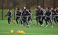 Pictured: Players warming up Wednesday 23 December 2015<br />Re: Swansea City FC training ahead of their West Bromwich Albion game, Fairwood, near Swansea, Wales, UK