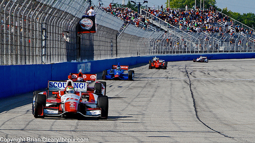Justin Wilson leads a pack of cars, Milwaukee Indy Fest 250, Milwaukee Mile Speedway, Milwaukee, WI, August 2014.  (Photo by Brian Cleary/www.bcpix.com)