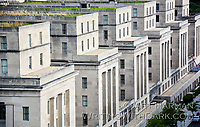 The row of pillars and wings of the building offered a unique symmetry, shot from the rooftop of another building.
