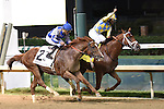 Noble Bird and jockey Shaun Bridgmohan win the Stephen Foster at Churchill Downs, for owner John Oxley and trainer Mark Casse.