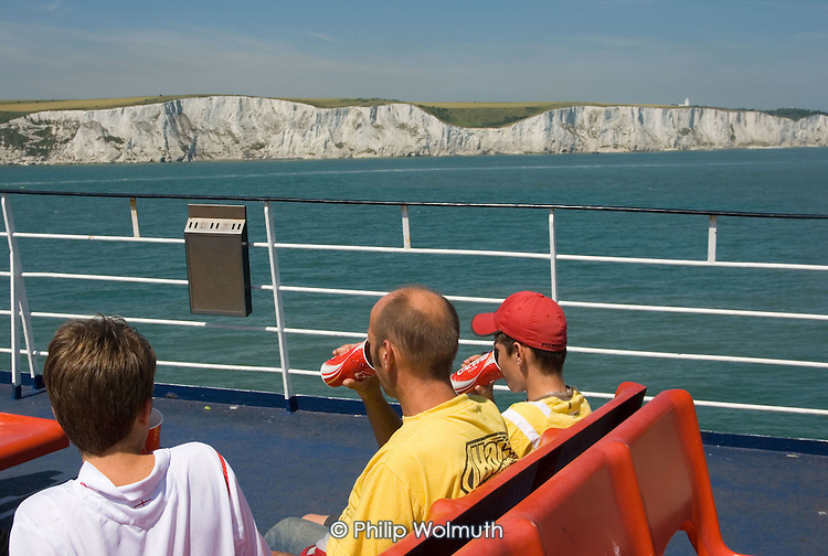 A P&O Dover-Calais ferry passes the white cliffs of Dover.