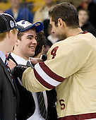 Mark Begert (BC - 5), Tommy Cross (BC - 4) - The Boston College Eagles defeated the Boston University Terriers 3-2 (OT) to win the 2012 Beanpot championship on Monday, February 13, 2012, at TD Garden in Boston, Massachusetts.