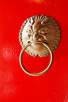 Door knocker on red door of temple in Po Fook Hill Cemetery, Sha Tin, New Territories, Hong Kong SAR, People's Repbulic of China, Asia