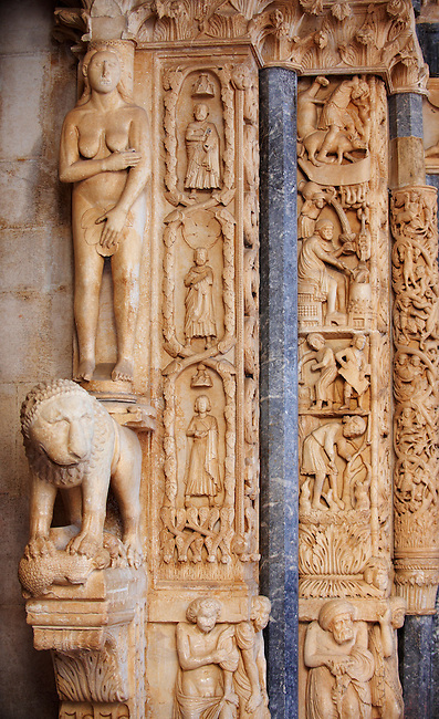 """Romaesque doorway with sculptures of Eve by the Croatian architect Master Radovan. Saint Lawrence Cathedral - Trogir - Croatia<br /> <br /> One of the most beautiful towns on the Croatian coast is Trogir. Surrounded by water Trogir is an unspoiled medieval city with narrow streets leading to its medieval Cathedral of St Lawrence. The Romanesque porch has wonderful early medieval sculptures by the Croatian architect Master Radovan. From the Cathedral tower there is a picturesque view across the pan tiled roof tops of Trogir. <br /> <br /> In the 3rd century BC, Tragurion was founded by Greek colonists from the island of Vis, and it developed into a major port until the Roman period. The name comes from the Greek """"tragos"""" (male goat). Similarly, the name of the neighbouring island of Bua comes from the Greek """"voua"""" (herd of cattle). The sudden prosperity of Salona deprived Trogir of its importance. During the migration of Slavs the citizens of the destroyed Salona escaped to Trogir. From the 9th century on, Trogir paid tribute to Croatian rulers. The diocese of Trogir was established in the 11th century (abolished in 1828; it is now part of the Roman Catholic Archdiocese of Split-Makarska) and in 1107 it was chartered by the Hungarian-Croatian king Coloman, gaining thus its autonomy as a town.<br /> <br /> Trogir should be high on any visit to Croatia"""