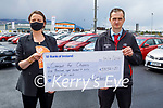 Brid O'Connor of Comfort for Chemo accepts a cheque for €5,852.51 from Gerard McCarthy (After Sales Manager) of Kellihers Toyota from their recent Shave and Dye fundraiser.