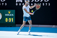 16th February 2021, Melbourne, Victoria, Australia; Grigor Dimitrov of Bulgaria returns the ball during the quarterfinals of the 2021 Australian Open on February 16 2021, at Melbourne Park in Melbourne, Australia.