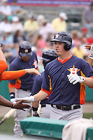 Houston Astros third baseman Matt Dominguez (30) is congratulated by his teammates after hitting a home run against the Miami Marlins during a spring training game at the Roger Dean Complex in Jupiter, Florida on March 12, 2013. Houston defeated Miami 9-4. (Stacy Jo Grant/Four Seam Images)........