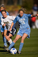 North Carolina Tar Heels midfielder Ali Hawkins (76) and Notre Dame Fighting Irish midfielder Brittany Bock (10). The North Carolina Tar Heels defeated the Notre Dame Fighting Irish 2-1 during the finals of the NCAA Women's College Cup at Wakemed Soccer Park in Cary, NC, on December 7, 2008. Photo by Howard C. Smith/isiphotos.com