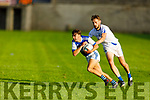 Kerins O'Rahillys Conor Hayes breaks from the tackle of Templenoe's Tom Spillane in the Senior Club football championship