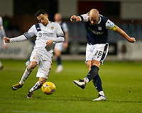 29th December 2020; Dens Park, Dundee, Scotland; Scottish Championship Football, Dundee FC versus Alloa Athletic; Kevin Cawley of Alloa Athletic can't stop Charlie Adam of Dundee firing in a shot