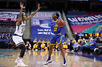 GREENSBORO, NC - MARCH 05: Gabbie Green #12 of University of Pittsburgh is guarded by Kierra Fletcher #41 of Georgia Tech during a game between Pitt and Georgia Tech at Greensboro Coliseum on March 05, 2020 in Greensboro, North Carolina.