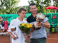 August 9, 2014, Netherlands, Rotterdam, TV Victoria, Tennis, National Junior Championships, NJK, Prize giving, Wimbledon winner Richard Krajicek gives the prize for the winner boys 14 years to his son Alec Deckers and shows his son his own name on the trophy<br /> Photo: Tennisimages/Henk Koster
