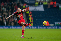 WEST BROMWICH, ENGLAND - FEBRUARY 11:  Jonjo Shelvey of Swansea City  kicks the ball forward during the Premier League match between West Bromwich Albion and Swansea City at The Hawthorns on February 11, 2015 in West Bromwich, England. (Photo by Athena Pictures/Getty Images)