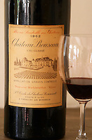 A bottle magnum of Chateau Bouscaut 1962 and a glass of 2003 Chateau Bouscaut Cru Classe Cadaujac Graves Pessac Leognan Bordeaux Gironde Aquitaine France