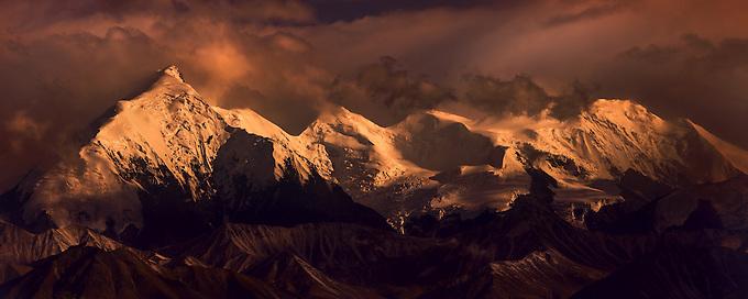Dramatic last light illuminates the Denali range.