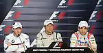05 Apr 2009, Kuala Lumpur, Malaysia ---   Brawn GP Formula One Team driver Jenson Button of Great Britain, Nick Heidfeld of Germany and BMW Sauber Timo Glock of Germany attend a news conference after the 2009 Fia Formula One Malasyan Grand Prix at the Sepang circuit near Kuala Lumpur. Photo by Victor Fraile --- Image by © Victor Fraile / The Power of Sport Images