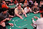 "Loaded table: David Saab, Greg Raymer and ""ElkY."""