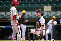 Bradenton Marauders catcher Eli Wilson (12) talks with Tommy Jew (21) during a game against the Palm Beach Cardinals on May 30, 2021 at LECOM Park in Bradenton, Florida.  (Mike Janes/Four Seam Images)