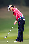 Je-Yoon Yang of Korea in action during the Hyundai China Ladies Open 2014 on December 12 2014 at Mission Hills Shenzhen, in Shenzhen, China. Photo by Li Man Yuen / Power Sport Images