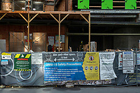 Signs detail COVID-19 safety precautions outside a construction site in Kendall Square in Cambridge, Massachusetts, on Mon., Jan. 4, 2021.